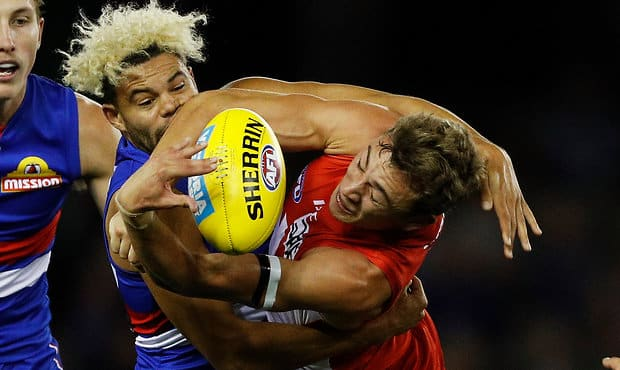 MELBOURNE, AUSTRALIA - APRIL 14:  Jason Johannisen of the Bulldogs tackles Will Hayward of the Swans during the round four AFL match between the Western Bulldogs and the Sydney Swans at Etihad Stadium on April 14, 2018 in Melbourne, Australia.  (Photo by Daniel Pockett/Getty Images/AFL Media) - Western Bulldogs