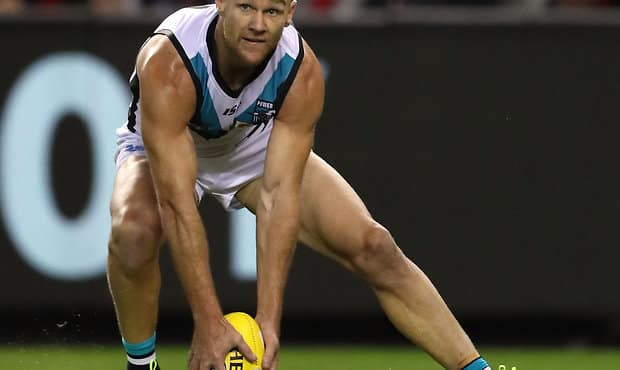 MELBOURNE, AUSTRALIA - APRIL 15: Robbie Gray of the Power gathers the ball during the 2018 AFL Round 04 match between the Essendon Bombers and the Port Adelaide Power at Etihad Stadium on April 15, 2018 in Melbourne, Australia. (Photo by Sean Garnsworthy/AFL Media)