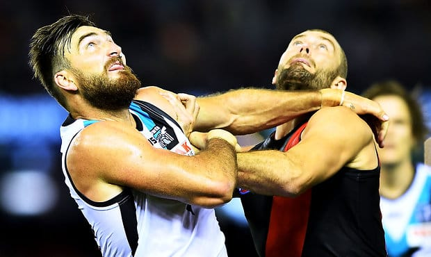 MELBOURNE, AUSTRALIA - APRIL 15:  Charlie Dixon of Port Adelaide and Tom Bellchambers of the Bombers battle iyt out in the ruck during the round four AFL match between the Essendon Bombers and the Port Adelaide Power at Etihad Stadium on April 15, 2018 in Melbourne, Australia.  (Photo by Mark Brake/Getty Images/AFL Media)