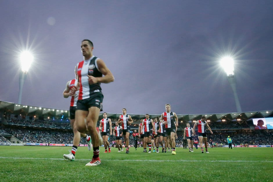 GEELONG, AUSTRALIA - APRIL 15:  St Kilda players run off the ground at half time during the round four AFL match between the Geelong Cats and the St Kilda Saints at GMHBA Stadium on April 15, 2018 in Geelong, Australia.  (Photo by Darrian Traynor/Getty Images/AFL Media)