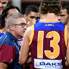 BRISBANE, AUSTRALIA - APRIL 22: Coach Chris Fagan of the Lions talks to his players in the 3rd quarter break during the 2018 AFL round five match between the Brisbane Lions and the Gold Coast Suns at The Gabba on April 22, 2018 in Brisbane, Australia. (Photo by Bradley Kanaris/AFL Media)