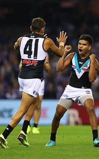 Jake Neade (right) celebrates a goal with Dom Barry
