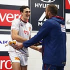 SYDNEY, AUSTRALIA - APRIL 28:  Oscar McInerney of the Lions (L) is presented with his jersey on debut by Ben Hudson (R) during the round six AFL match between the Greater Western Sydney Giants and the Brisbane Lions at Spotless Stadium on April 28, 2018 in Sydney, Australia.  (Photo by Matt King/AFL Media) *
