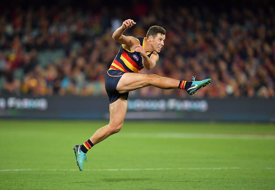 ADELAIDE, AUSTRALIA - APRIL 28: Luke Brown of the Crows kicks the ball during the round six AFL match between the Adelaide Crows and Gold Coast Suns at Adelaide Oval on April 28, 2018 in Adelaide, Australia.  (Photo by Daniel Kalisz/Getty Images/AFL Media)