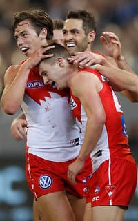 Oliver Florent and Josh Kennedy help Ben Ronke celebrate one of his seven goals