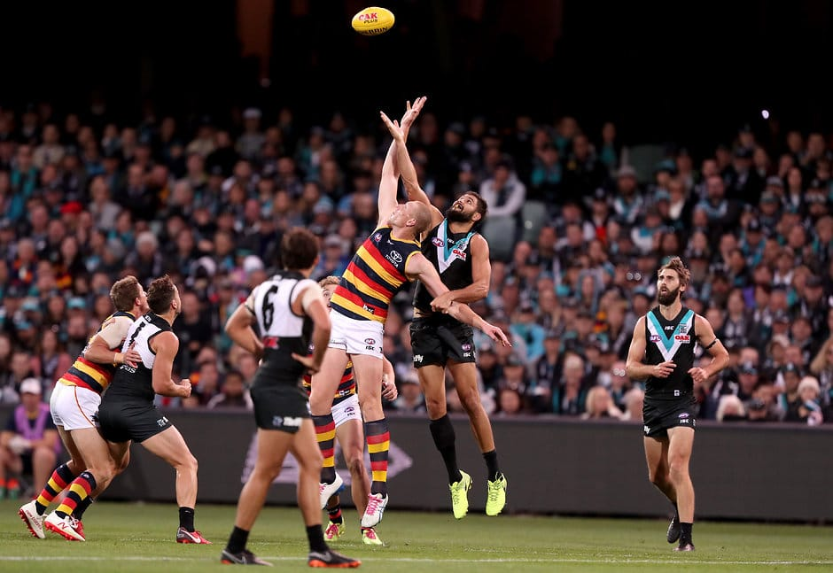 ADELAIDE, AUSTRALIA - MAY 12: Paddy Ryder of the Power clashes with Sam Jacobs of the Crows during the 2018 AFL round eight match between the Port Adelaide Power and the Adelaide Crows at Adelaide Oval on May 12, 2018 in Adelaide, Australia. (Photo by James Elsby/AFL Media)