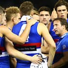 MELBOURNE, AUSTRALIA - MAY 12:  Bulldogs head coach Luke Beveridge speaks to his players during the round eight AFL match between the Western Bulldogs and the Brisbane Lions at Etihad Stadium on May 12, 2018 in Melbourne, Australia.  (Photo by Michael Dodge/Getty Images/AFL Media)