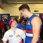 MELBOURNE, AUSTRALIA - MAY 12:  Marcus Bontempelli of the Bulldogs celebrates with a supporter in the rooms after winning the 2018 AFL round eight match between the Western Bulldogs and the Brisbane Lions at Etihad Stadium on May 12, 2018 in Melbourne, Australia. (Photo by Scott Barbour/AFL Media)