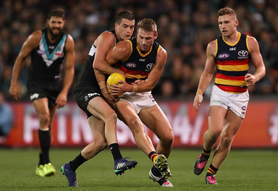 ADELAIDE, AUSTRALIA - MAY 12: Daniel Talia of the Crows is tackled by Tom Rockliff of the Power during the 2018 AFL round eight match between the Port Adelaide Power and the Adelaide Crows at Adelaide Oval on May 12, 2018 in Adelaide, Australia. (Photo by Matt Turner/AFL Media)