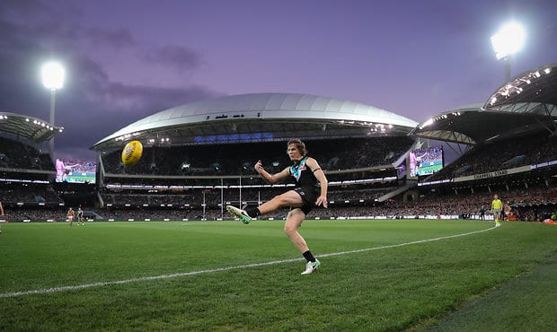 ADELAIDE, AUSTRALIA - MAY 12: Jared Polec of the Power kicks the ball during the 2018 AFL round eight match between the Port Adelaide Power and the Adelaide Crows at Adelaide Oval on May 12, 2018 in Adelaide, Australia. (Photo by Matt Turner/AFL Media)