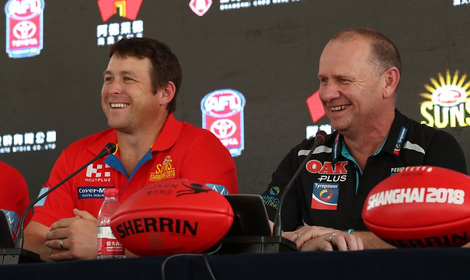 SHANGHAI, CHINA - MAY 17: Stuart Dew, Senior Coach of the Suns and Ken Hinkley, Senior Coach of the Power address the media during a press conference launching the round 9 match between the Gold Coast Suns and Port Adelaide on May 16, 2018 in Shanghai, China. (Photo by /Sean Garnsworthy/AFL Media)