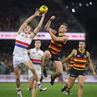ADELAIDE, AUSTRALIA - MAY 18: Bailey Dale of the Bulldogs clashes with Rory Laird of the Crows during the 2018 AFL round nine match between the Adelaide Crows and the Western Bulldogs at the Adelaide Oval on May 18, 2018 in Adelaide, Australia. (Photo by AFL Media)