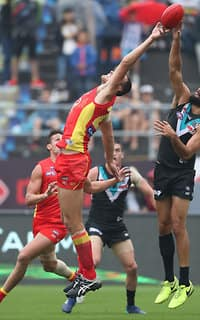 Gold Coast's Jarrod Witts and Port Adelaide's Paddy Ryder contest the ruck