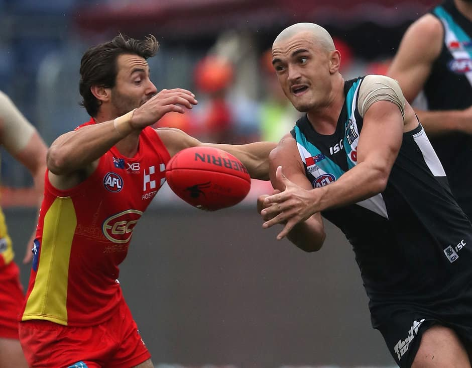 SHANGHAI, CHINA - MAY 19: Sam Powell-Pepper of the Power handballs during the 2018 AFL round nine match between the Gold Coast Suns and the Port Adelaide Power at Adelaide Arena at Jiangwan Sports Stadium on May 19, 2018 in Shanghai, China. (Photo by Sean Garnsworthy/AFL Media)