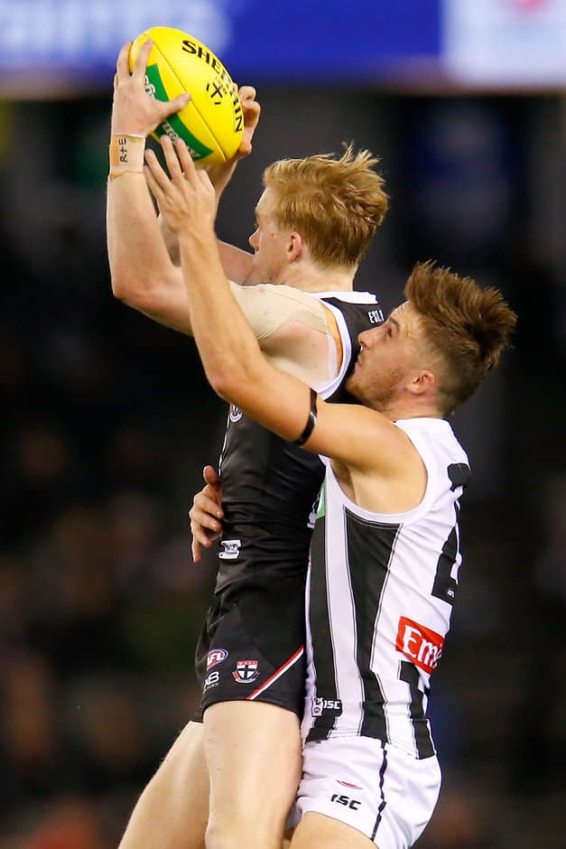 Ed Phillips marks in front of brother Tom on Saturday night - AFL,Ed Phillips,Tom Phillips,Collingwood Magpies,St Kilda Saints