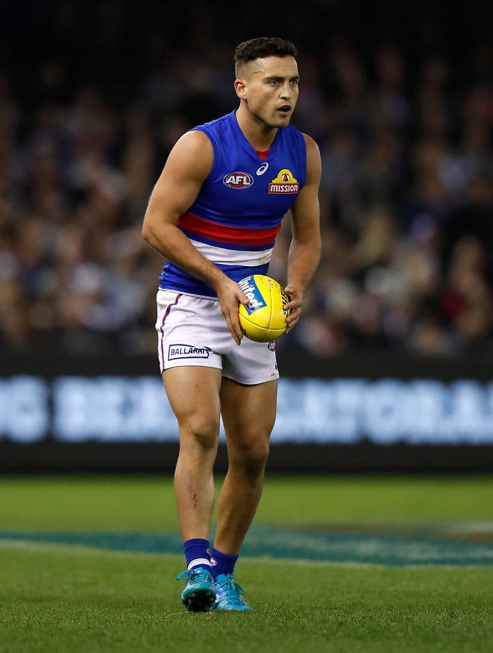 Dahlhaus was brought down in a tackle in the early stages of the second quarter of Sunday's 54-point loss to the West Coast Eagles. (Photo: AFL Media) - Western Bulldogs