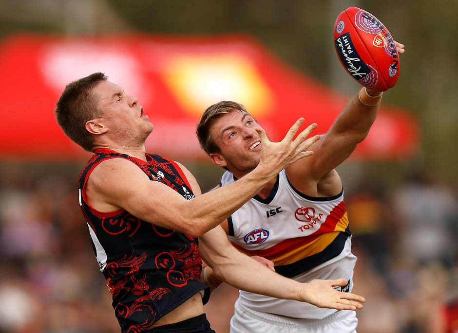 ALICE SPRINGS, AUSTRALIA - MAY 27: Tom McDonald of the Demons and Daniel Talia of the Crows compete for the ball during the 2018 AFL round 10 match between the Melbourne Demons and the Adelaide Crows at TIO Traeger Park on May 27, 2018 in Alice Springs, Australia. (Photo by Michael Willson/AFL Media)