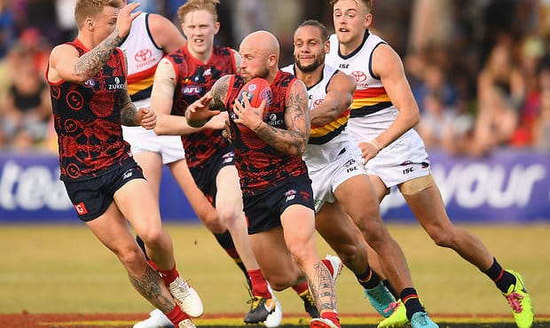 ALICE SPRINGS, AUSTRALIA - MAY 27:  Nathan Jones of the Demons clears the ball out of the centre during the round 10 AFL match between the Melbourne Demons and the Adelaide Crows at Traeger Park on May 27, 2018 in Alice Springs, Australia.  (Photo by Quinn Rooney/Getty Images/AFL Media)