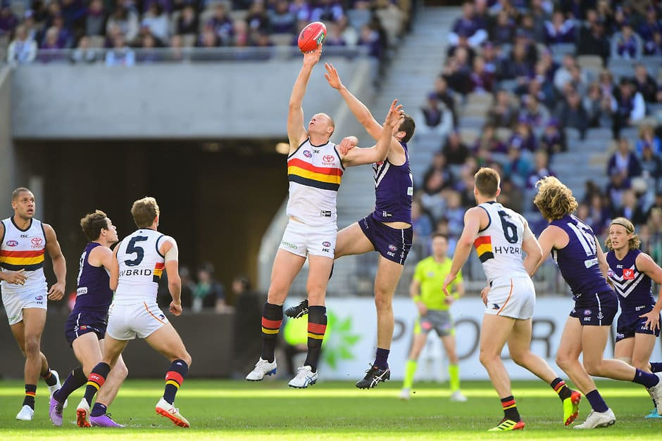 PERTH, AUSTRALIA - JUNE 10: Sam Jacobs of the Crows contests a ruck with Michael Apeness of the Dockers during the 2018 AFL round 12 match between the Fremantle Dockers and the Adelaide Crows at Optus Stadium on June 10, 2018 in Perth, Australia. (Photo by Daniel Carson/AFL Media)