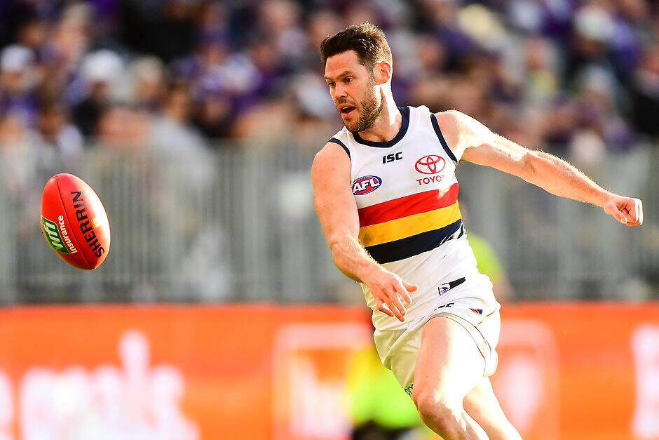 PERTH, AUSTRALIA - JUNE 10: Sam Gibson of the Crows chases down a loose ball during the 2018 AFL round 12 match between the Fremantle Dockers and the Adelaide Crows at Optus Stadium on June 10, 2018 in Perth, Australia. (Photo by Daniel Carson/AFL Media)