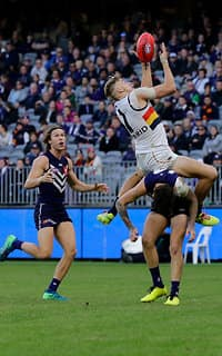 PERTH, AUSTRALIA - JUNE 10: Hugh Greenwood of the Crows takes an overhead mark during the 2018 AFL round 12 match between the Fremantle Dockers and the Adelaide Crows at Optus Stadium on June 10, 2018 in Perth, Australia. (Photo by Will Russell/AFL Media)