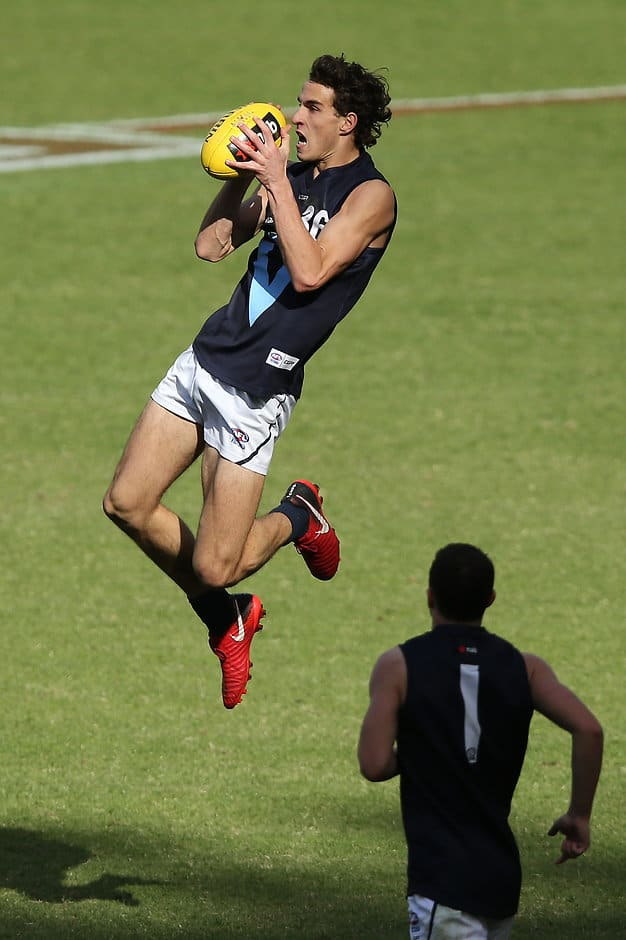 Ben King jumps for a mark against the Allies - AFL,Under-18s