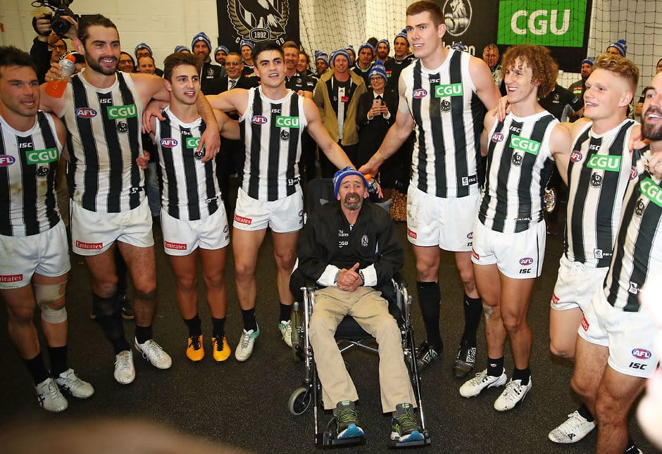 Murray Swinton and the Collingwood team celebrate the Pies' big win over Queen's Birthday win over Melbourne in 2018 - Collingwood Magpies