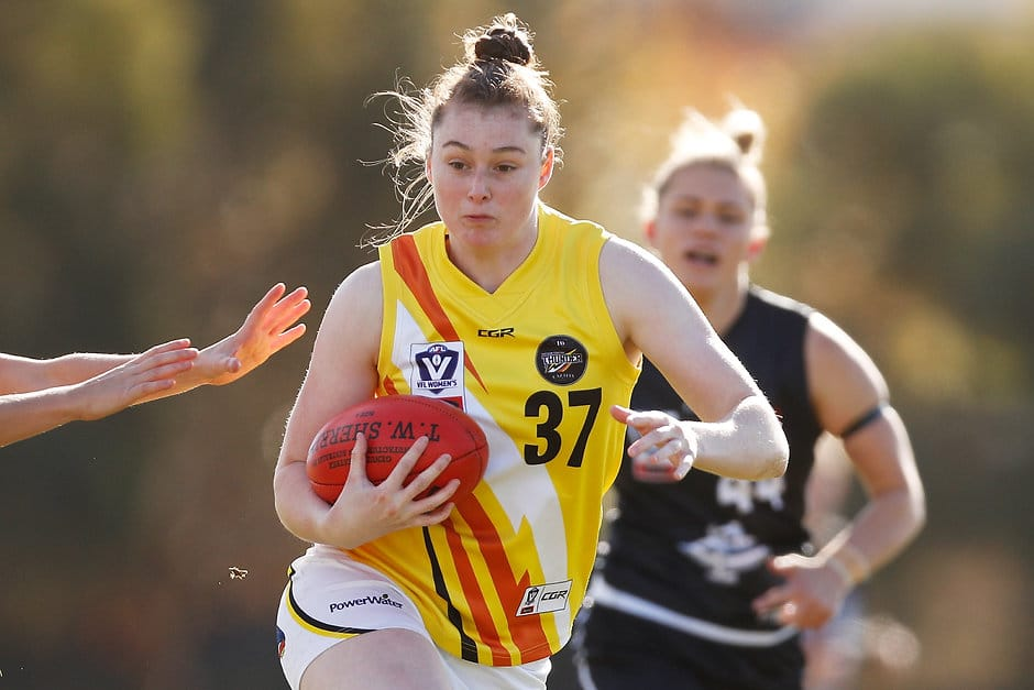 MELBOURNE, AUSTRALIA - JUNE 16:  Sarah Allan of the Thunder runs with the ball during the round six VFLW match between Carlton and NT Thunder at RAMS Arena on June 16, 2018 in Melbourne, Australia.  (Photo by Daniel Pockett/AFL Media)