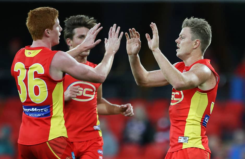 GOLD COAST, AUSTRALIA - JUNE 16:Nick Holman of the Suns celebrates kicking a goal  during the 2018 AFL round 13 match between the Gold Coast Suns and the St Kilda Saints at Metricon Stadium on June 16, 2018 in the Gold Coast, Australia. (Photo by Jason O'Brien/AFL Media)