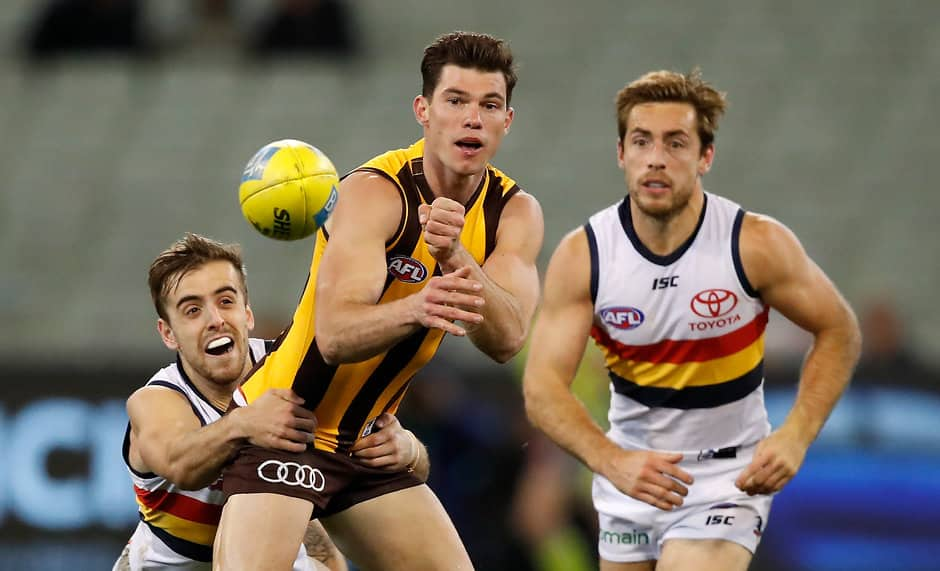 MELBOURNE, AUSTRALIA - JUNE 16: Jaeger O'Meara of the Hawks is tackled by Jordan Gallucci of the Crows during the 2018 AFL round 13 match between the Hawthorn Hawks and the Adelaide Crows at the Melbourne Cricket Ground on June 16, 2018 in Melbourne, Australia. (Photo by Adam Trafford/AFL Media)