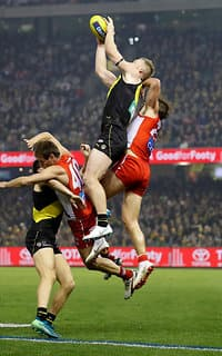 Richmond's Jack Riewoldt flies high for a mark over Sydney's Nick Smith