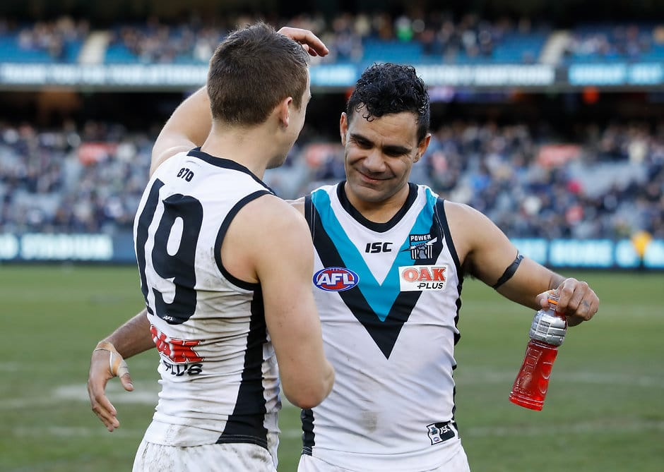 MELBOURNE, AUSTRALIA - JUNE 30: Jack Trengove of the Power (left) celebrates his first win for the club with Lindsay Thomas of the Power during the 2018 AFL round 15 match between the Carlton Blues and the Port Adelaide Power at the Melbourne Cricket Ground on June 30, 2018 in Melbourne, Australia. (Photo by Adam Trafford/AFL Media)