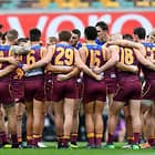 BRISBANE, AUSTRALIA - JULY 07: Lions players embrace before the start of the round 16 AFL match between the Brisbane Lions and the Carlton Blues at The Gabba on July 7, 2018 in Brisbane, Australia.  (Photo by Bradley Kanaris/Getty Images/AFL Media)