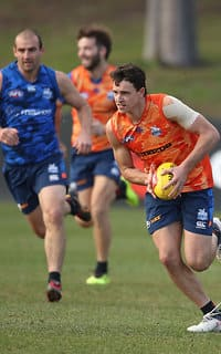MELBOURNE, AUSTRALIA - JULY 12:  Luke Davies-Uniacke of the Kangaroos runs with the ball during a North Melbourne Kangaroos Training Session on July 12, 2018 in Melbourne, Australia.  (Photo by Scott Barbour/Getty Images/AFL Media)