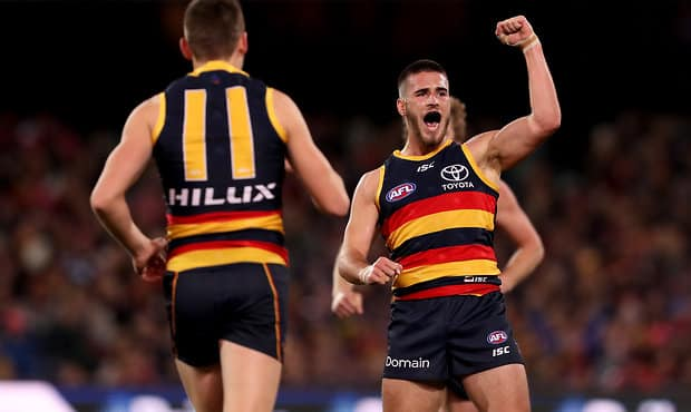 ADELAIDE, AUSTRALIA - JULY 12: Lachlan Murphy of the Crows celebrates a goal during the 2018 AFL round 17 match between the Adelaide Crows and the Geelong Cats at Adelaide Oval on July 12, 2018 in Adelaide, Australia. (Photo by James Elsby/AFL Media)