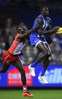 Kangaroo Majak Daw marks in front of Sydney's Aliir Aliir