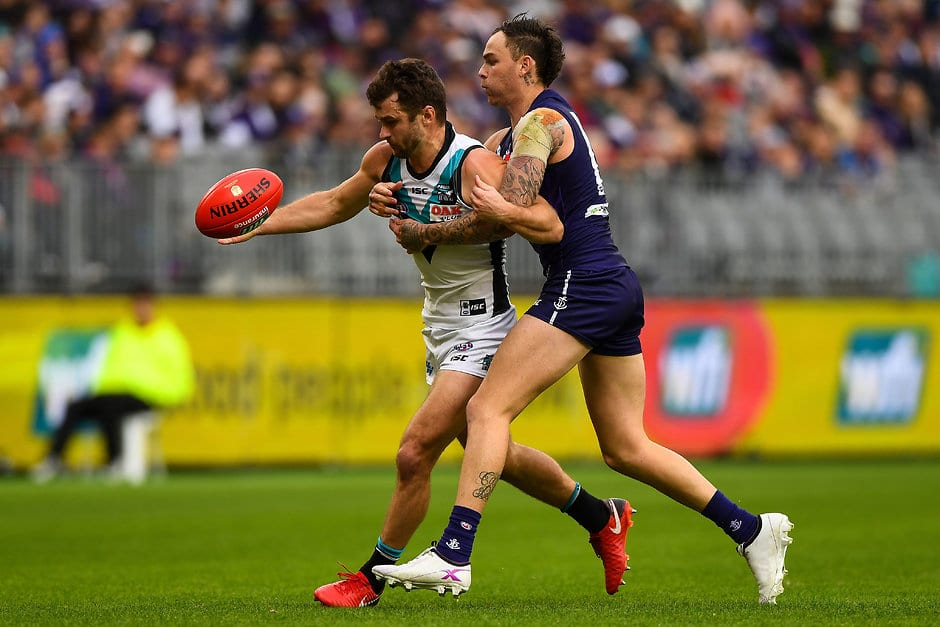 PERTH, AUSTRALIA - JULY 15: Sam Gray of the Power competes for the ball against Nathan Wilson of the Dockers during the 2018 AFL round 17 match between the Fremantle Dockers and the Port Adelaide Power at Optus Stadium on July 15, 2018 in Perth, Australia. (Photo by Daniel Carson/AFL Media)