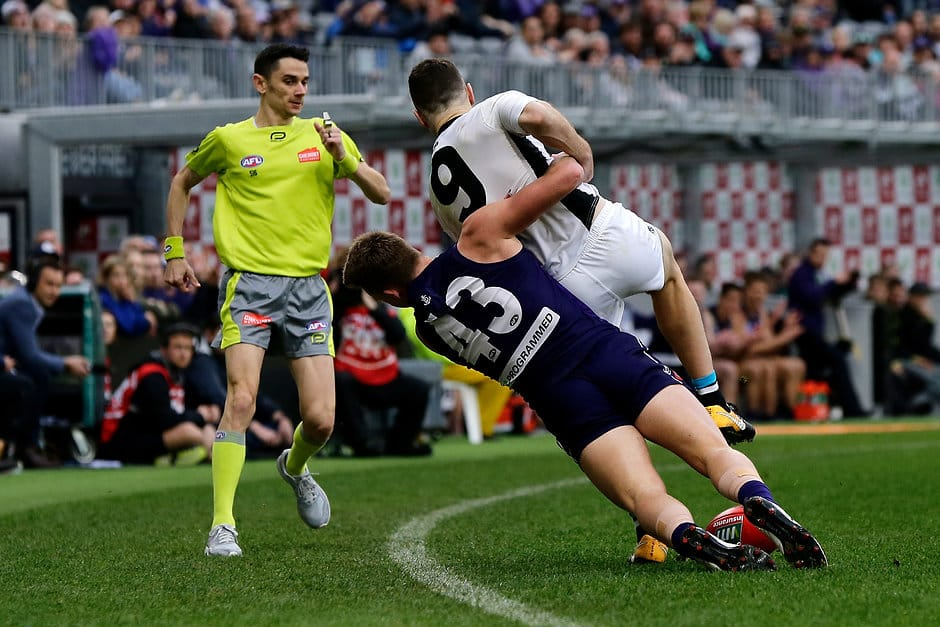 PERTH, AUSTRALIA - JULY 15: Robbie Gray of the Power is tackled by Ryan Nyhuis of the Dockers during the 2018 AFL round 17 match between the Fremantle Dockers and the Port Adelaide Power at Optus Stadium on July 15, 2018 in Perth, Australia. (Photo by Will Russell/AFL Media)