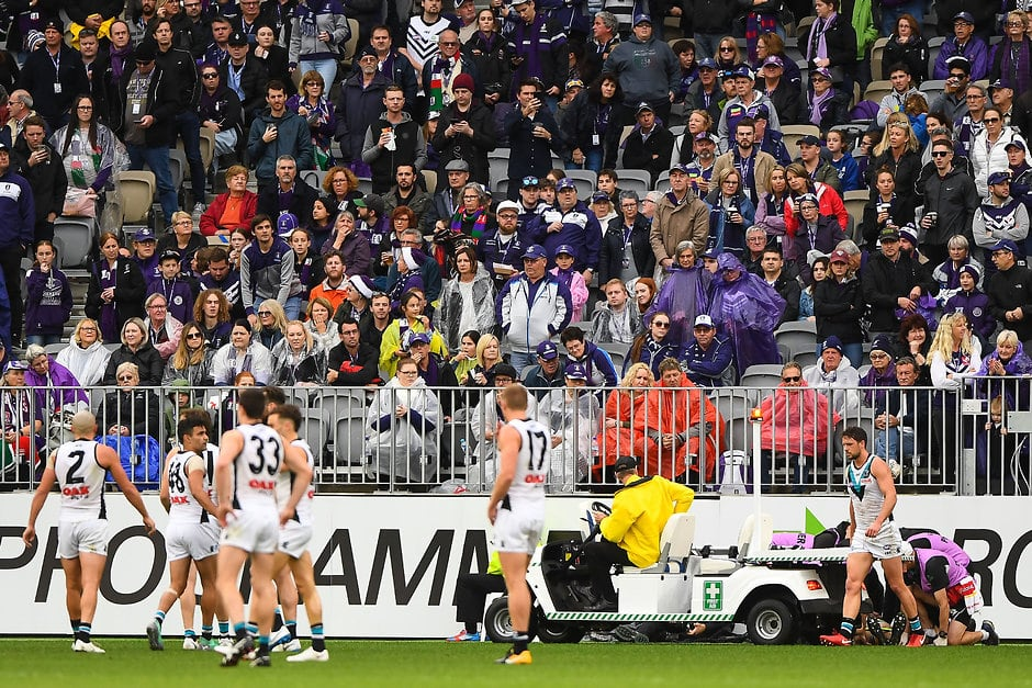 PERTH, AUSTRALIA - JULY 15: Robbie Gray of the Power is loaded onto the stretcher after being knocked out during the 2018 AFL round 17 match between the Fremantle Dockers and the Port Adelaide Power at Optus Stadium on July 15, 2018 in Perth, Australia. (Photo by Daniel Carson/AFL Media)