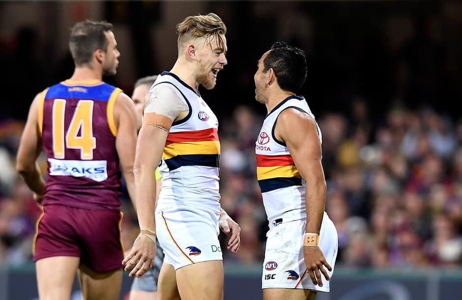 BRISBANE, AUSTRALIA - JULY 21: Hugh Greenwood of the Crows celebrates with Eddie Betts after kicking a goal during the round 18 AFL match between the Brisbane Lions and the Adelaide Crows at The Gabba on July 21, 2018 in Brisbane, Australia.  (Photo by Bradley Kanaris/Getty Images/AFL Media)