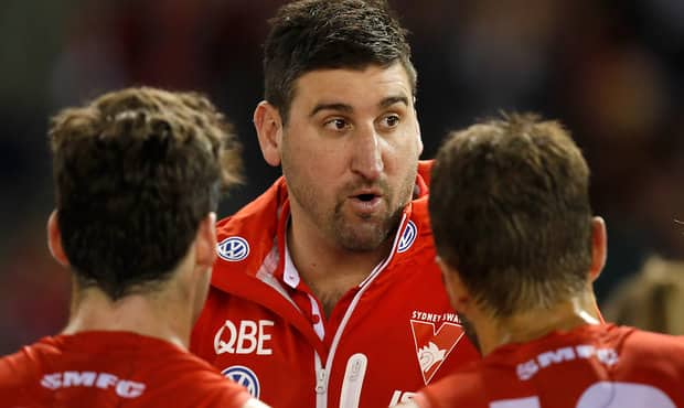 MELBOURNE, AUSTRALIA - JULY 27: Dean Cox, Assistant Coach of the Swans addresses his players during the 2018 AFL round 19 match between the Essendon Bombers and the Sydney Swans at Etihad Stadium on July 27, 2018 in Melbourne, Australia. (Photo by Michael Willson/AFL Media)