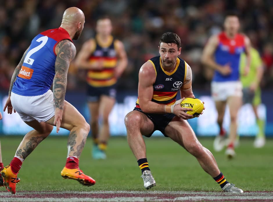 ADELAIDE, AUSTRALIA - JULY 28: Rory Atkins of the Crows about to be tackled by Nathan Jones of the Demons during the 2018 AFL round 19 match between the Adelaide Crows and the Melbourne Demons at Adelaide Oval on July 28, 2018 in Adelaide, Australia. (Photo by AFL Media)