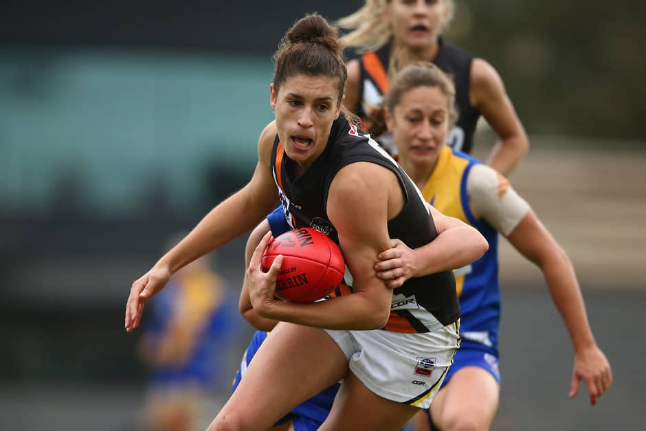 MELBOURNE, AUSTRALIA - AUGUST 04:  Jasmyn Hewett of the Thunder is tackled during the round 13 VFLW match between North Melbourne and NT Thunder at Avalon Airport Oval on August 4, 2018 in Melbourne, Australia.  (Photo by Mike Owen/AFL Media)