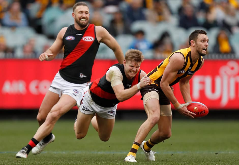 MELBOURNE, AUSTRALIA - AUGUST 04: Jack Gunston of the Hawks is tackled by Michael Hurley of the Bombers during the 2018 AFL round 20 match between the Hawthorn Hawks and the Essendon Bombers at the Melbourne Cricket Ground on August 04, 2018 in Melbourne, Australia. (Photo by Michael Willson/AFL Media)