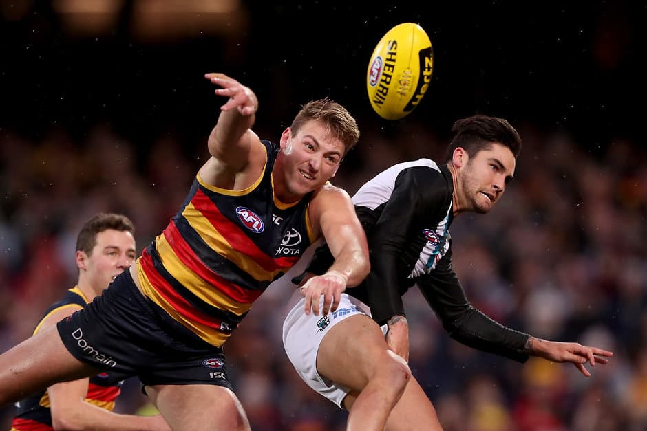 ADELAIDE, AUSTRALIA - AUGUST 04: Daniel Talia of the Crows clashes with Chad Wingard of the Power during the 2018 AFL round 20 match between the Adelaide Crows and the Port Adelaide Power at the Adelaide Oval on August 04, 2018 in Adelaide, Australia. (Photo by James Elsby/AFL Media)