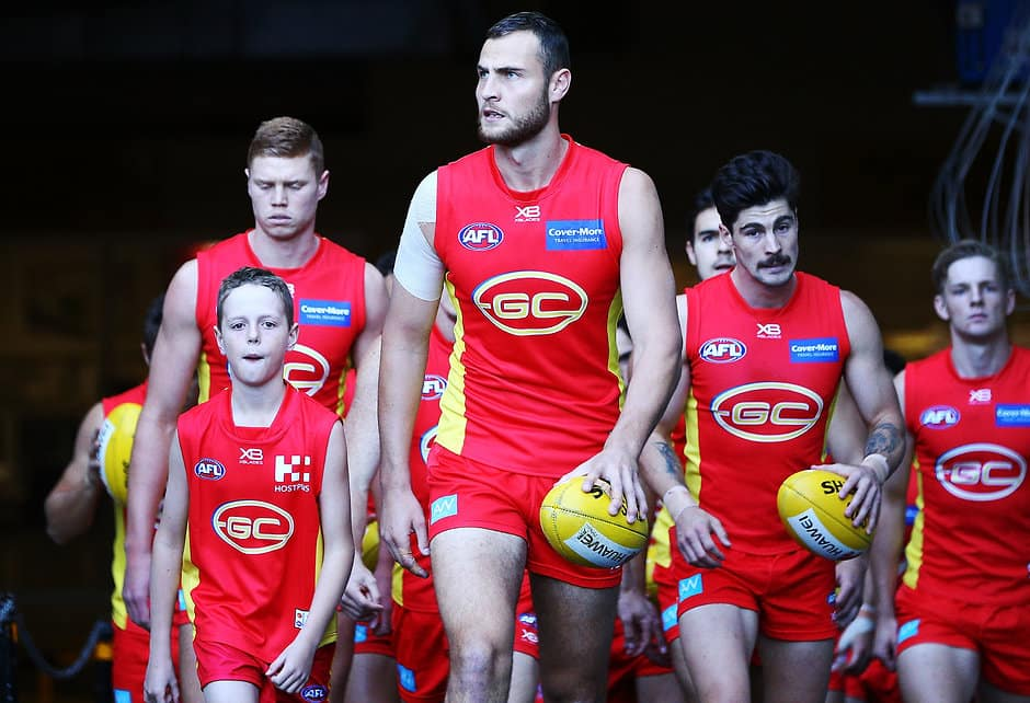 MELBOURNE, AUSTRALIA - AUGUST 05: Jarrod Witts of the Suns leads the team out during the round 20 AFL match between the Melbourne Demons and the Gold Coast Suns at Melbourne Cricket Ground on August 5, 2018 in Melbourne, Australia.  (Photo by Michael Dodge/Getty Images/AFL Media)