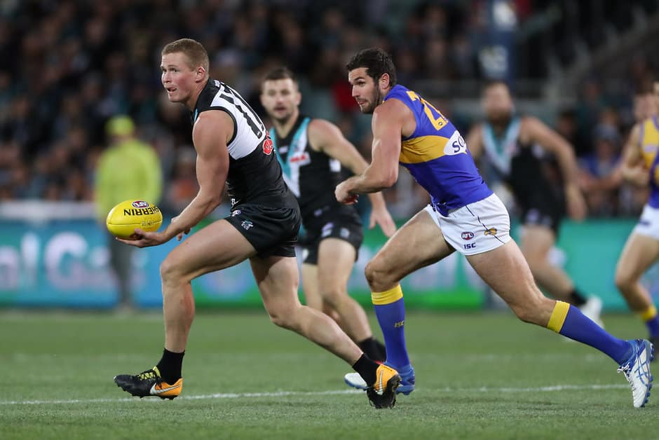ADELAIDE, AUSTRALIA - AUGUST 11: Tom Clurey of the Power breaks away from Jack Darling of the Eagles during the 2018 AFL round 21 match between the Port Adelaide Power and the West Coast Eagles at Adelaide Oval on August 11, 2018 in Adelaide, Australia. (Photo by AFL Media)