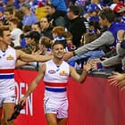 MELBOURNE, AUSTRALIA - AUGUST 12:  Caleb Daniel of the Bulldogs celebrates with supporters in the crowd after winning the round 21 AFL match between the North Melbourne Kangaroos and the Western Bulldogs at Etihad Stadium on August 12, 2018 in Melbourne, Australia.  (Photo by Scott Barbour/Getty Images/AFL Media)