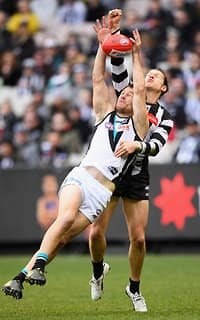 Robbie Gray attempts a mark under pressure from Tom Langdon