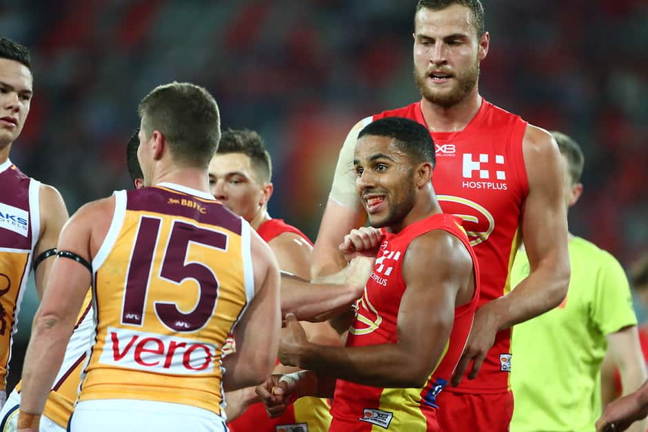 Touk Miller clashes with Dayne Zorko after last year's round 22 match - AFL,Gold Coast Suns,Brisbane Lions,Dayne Zorko,Touk Miller